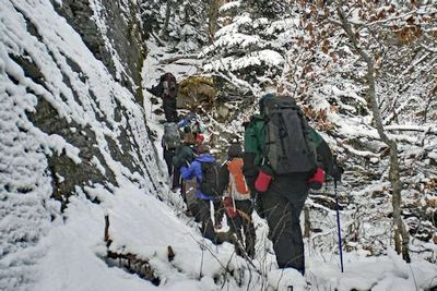 "Hikers negotiating ""the wall"" during off-trail hike of Friday Mountain"